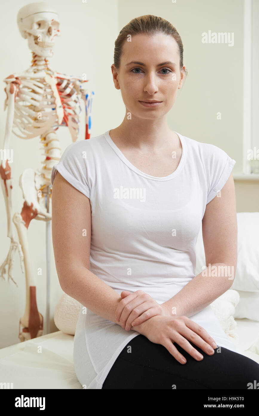 Portrait Of Female Osteopath In Consulting Room - Stock Image