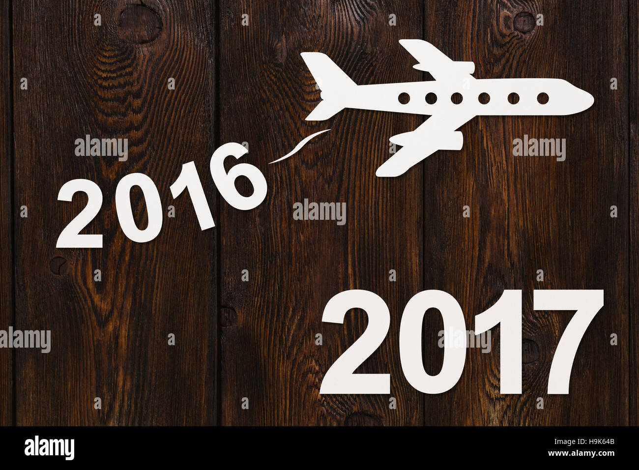 Paper flying plane. Abstract conceptual image. New year concept - Stock Image