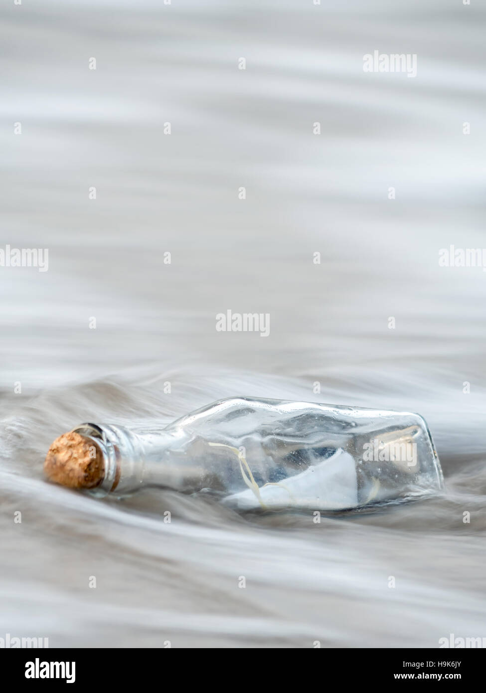 Message in the bottle washed ashore - Stock Image