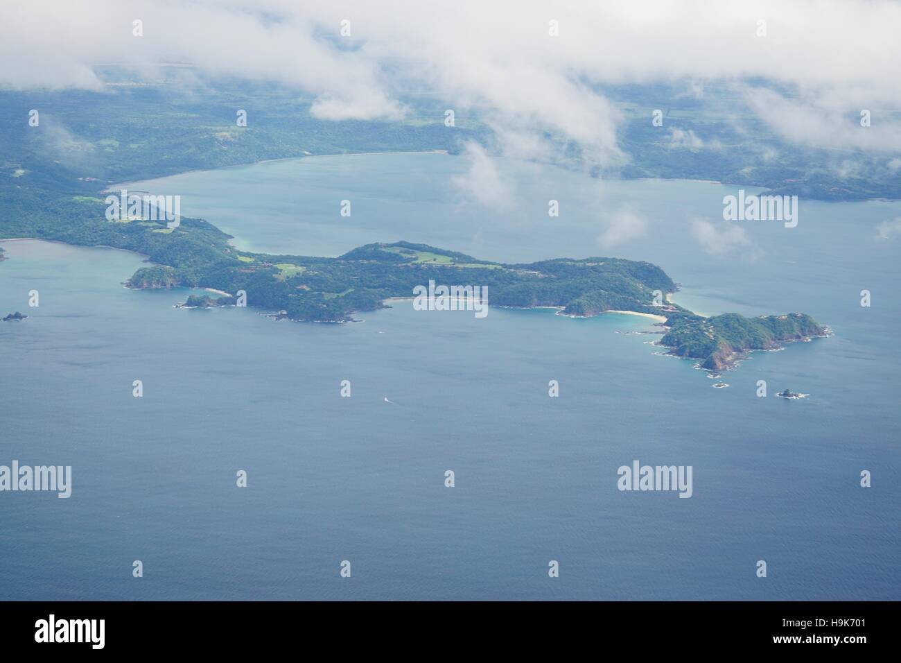 Aerial view in the clouds of the Golfo del Papagayo with the Peninsula Papagayo near Liberia in the Guanacaste Province - Stock Image