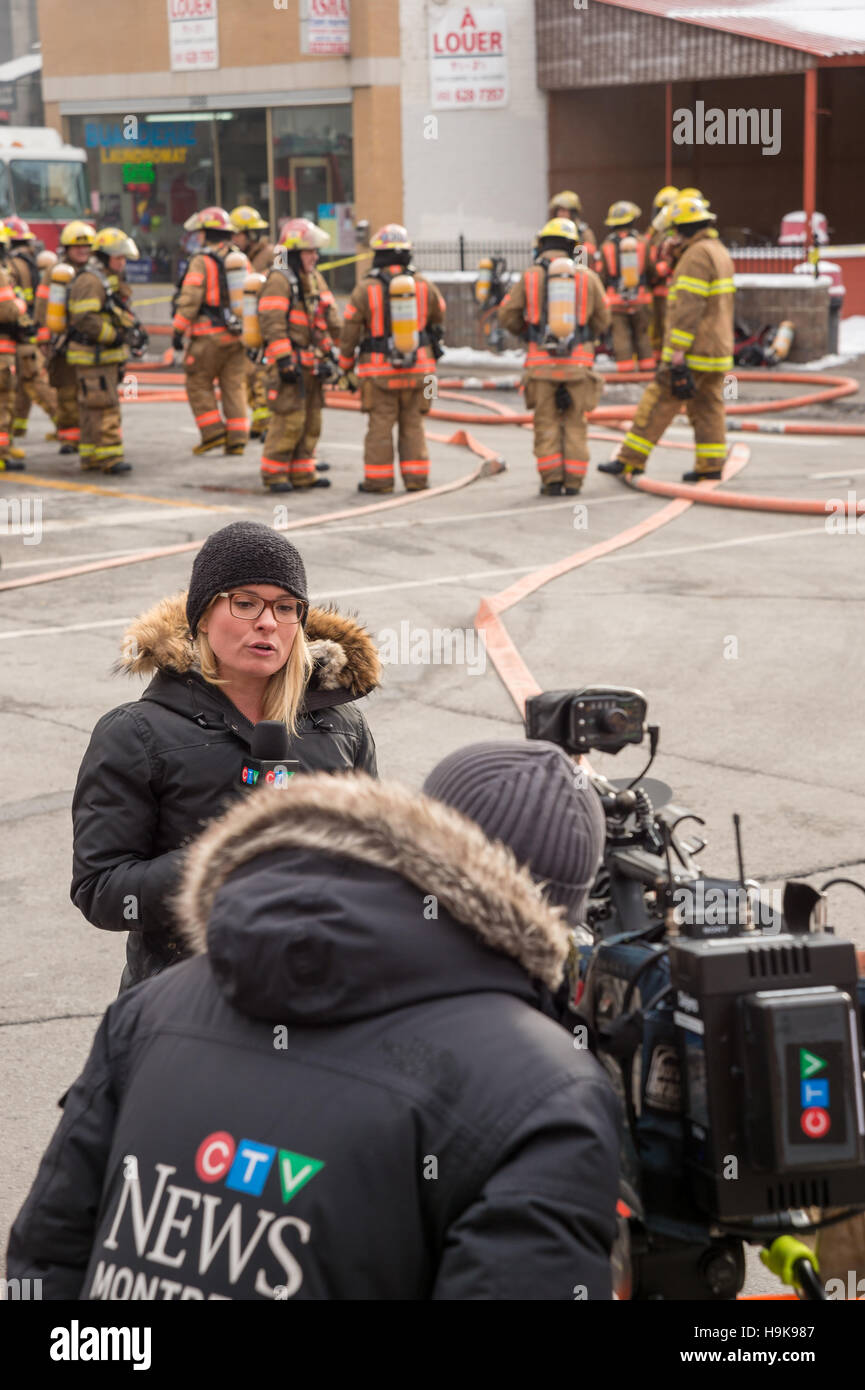 Montreal, CA - 23 Nov 2016: CTV News Reporter Annie Demelt at the scene covering Fire of 'Cafe Amusement 68' - Stock Image