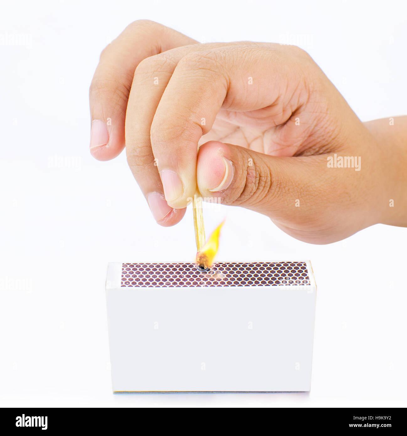 Burning match stick in white background - Stock Image