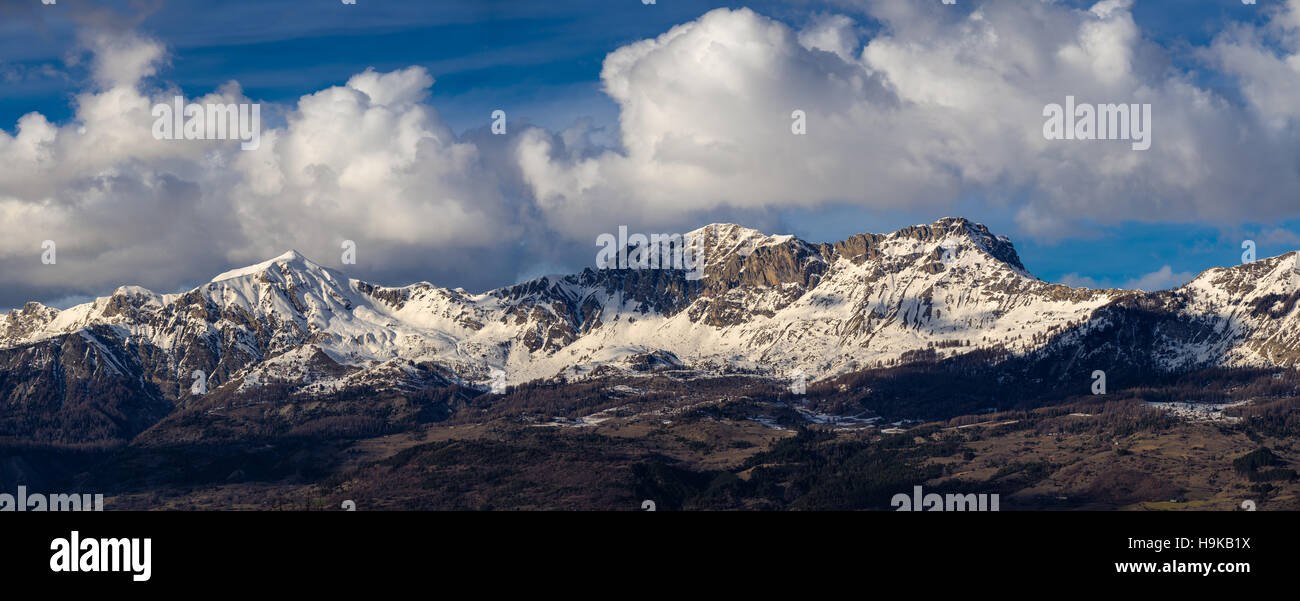 Snow covered Piolit and Parias mountain peaks. Winter in Hautes Alpes, Southern French Alps, France - Stock Image