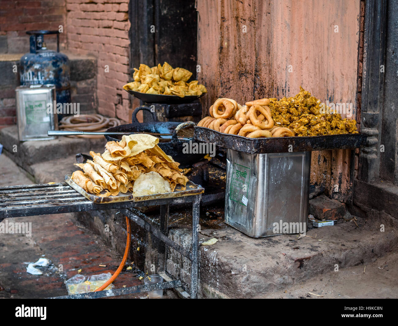 Nepali fried food for sale on the street - Stock Image
