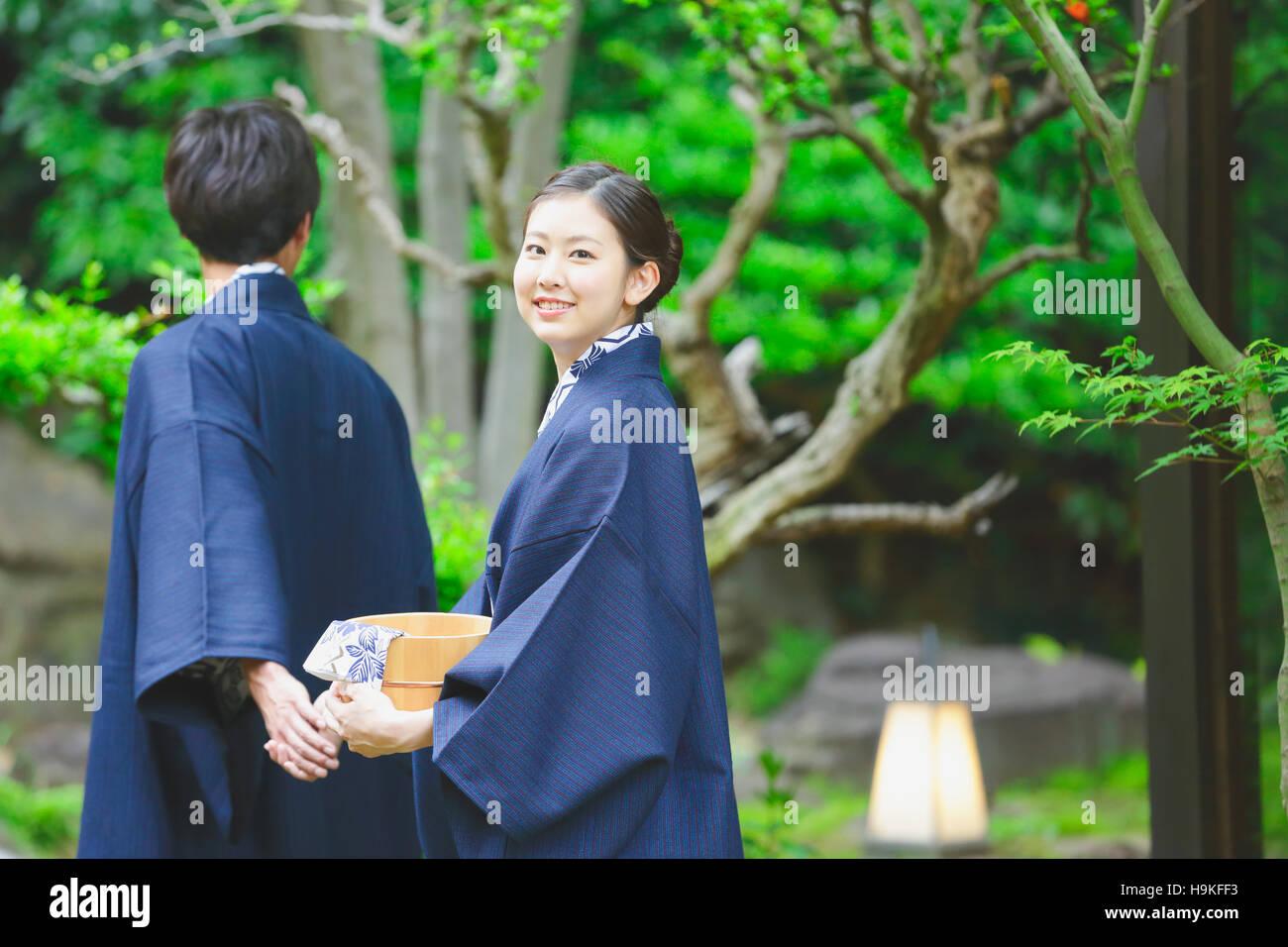 Young Japanese couple wearing yukata at traditional onsen hot spring ...
