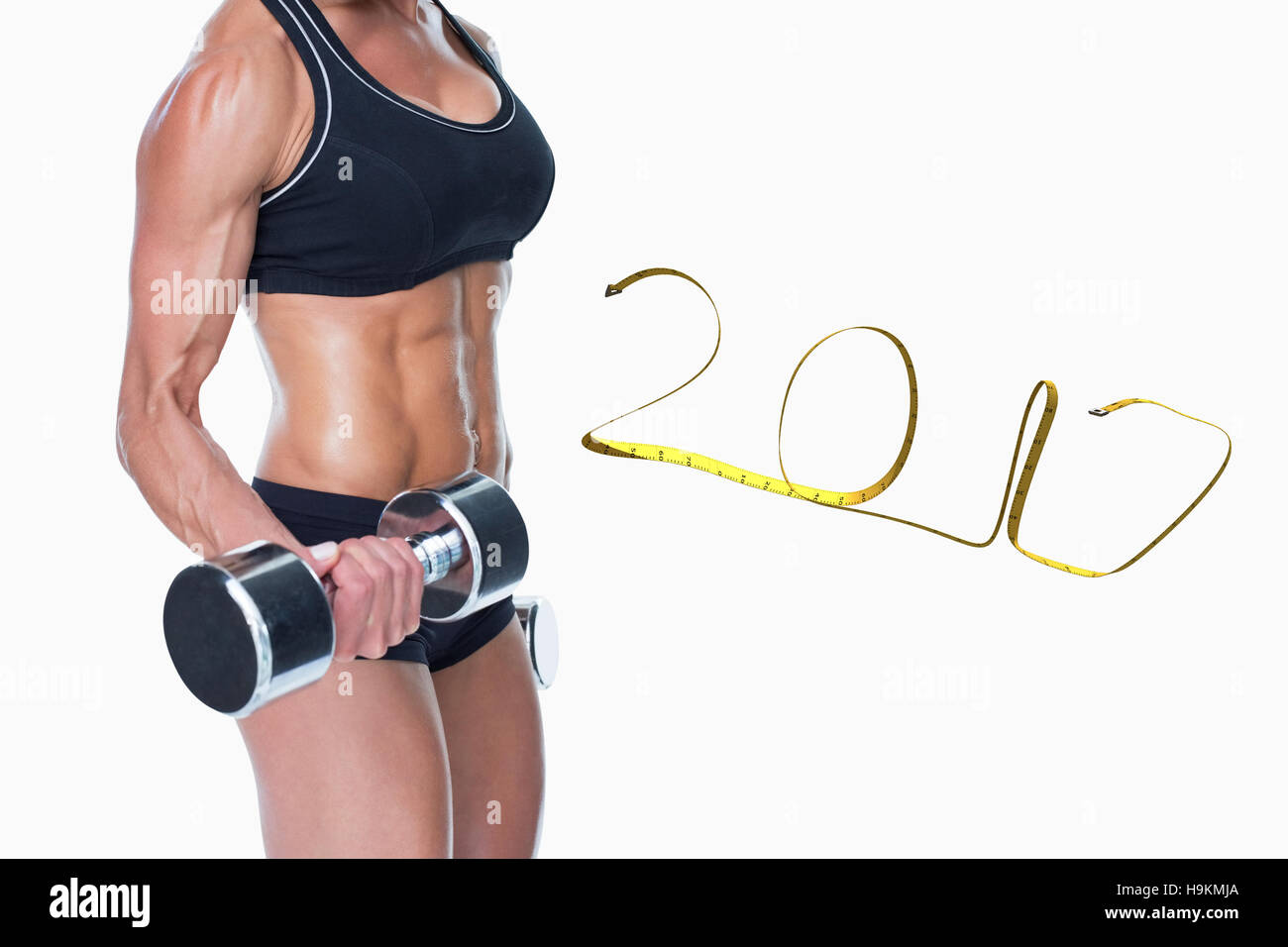 3D Composite image of female bodybuilder working out with large dumbbells mid section - Stock Image