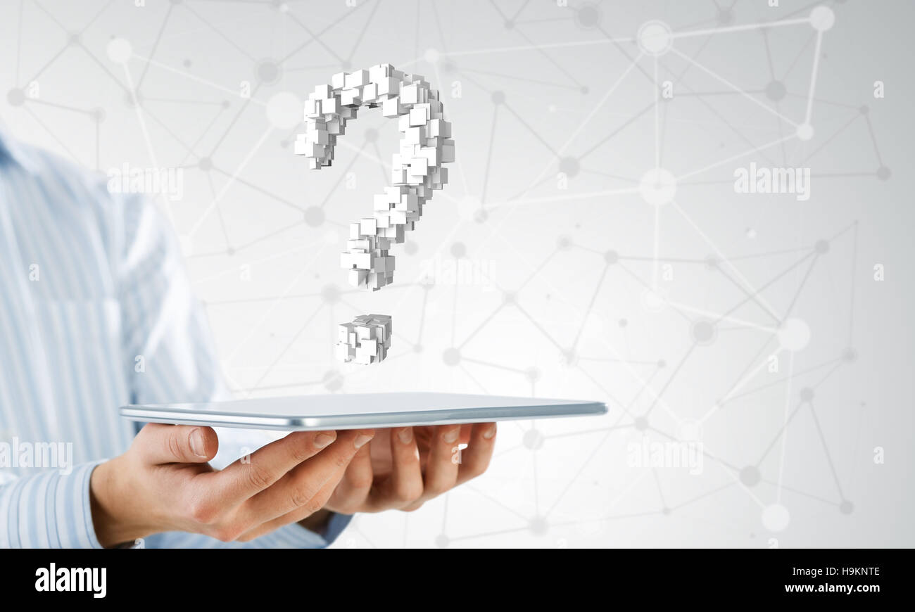 Question mark on tablet screen - Stock Image