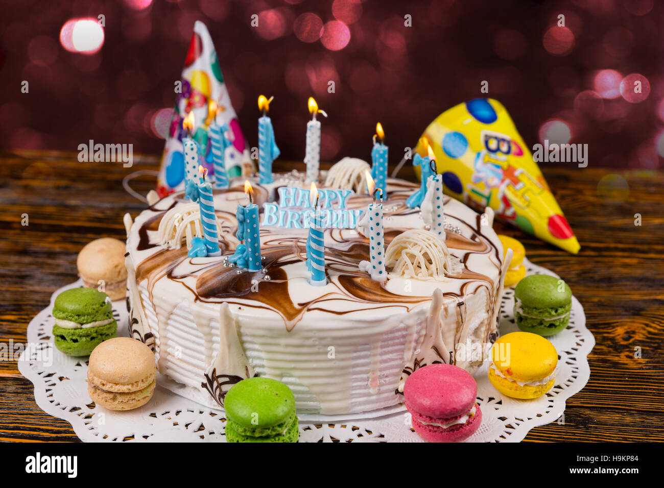 Homemade Birthday Cake With Lots Of Burning Candles On White Napkin
