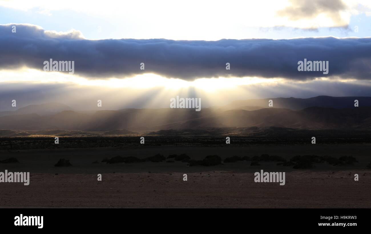 Rain Cloud and Sun Beam's after Storm - Stock Image
