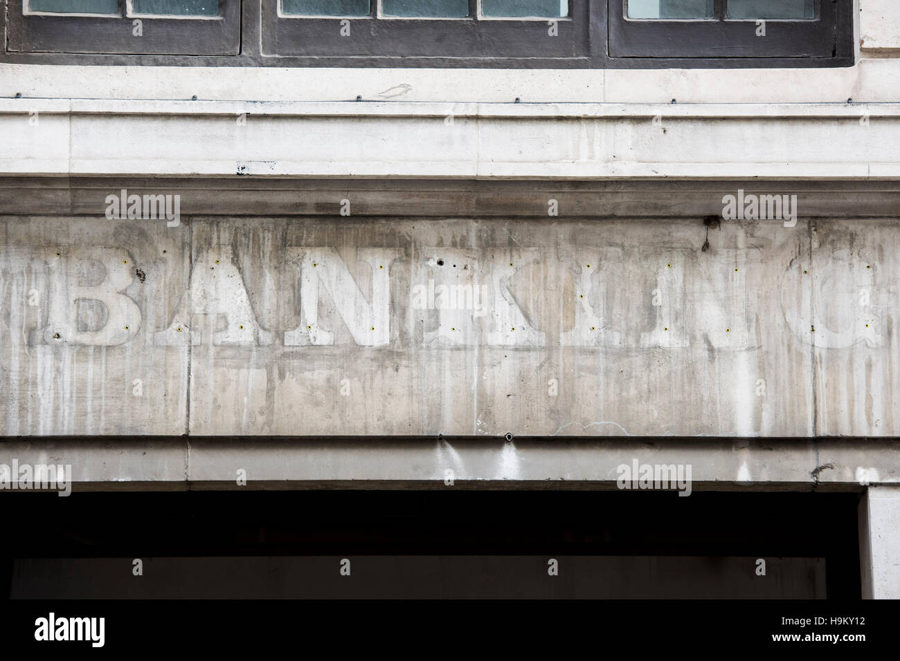Faded signage on a closed bank in the City of London. Several financial institutions rumoured to be planning a move - Stock Image