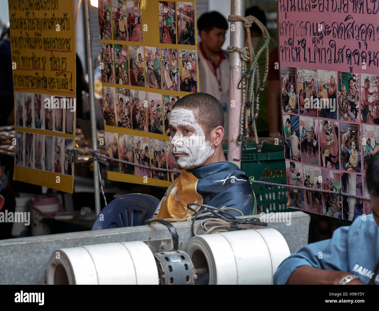 Western male undergoing face hair removal and beautification treatment in Thailand S. E. Asia - Stock Image
