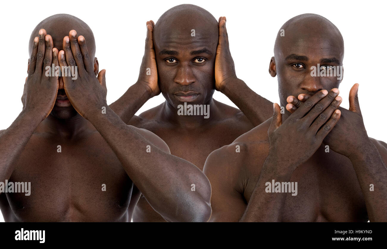 Dark-skinned man, not wanting to see, hear and say, three wise monkeys - Stock Image