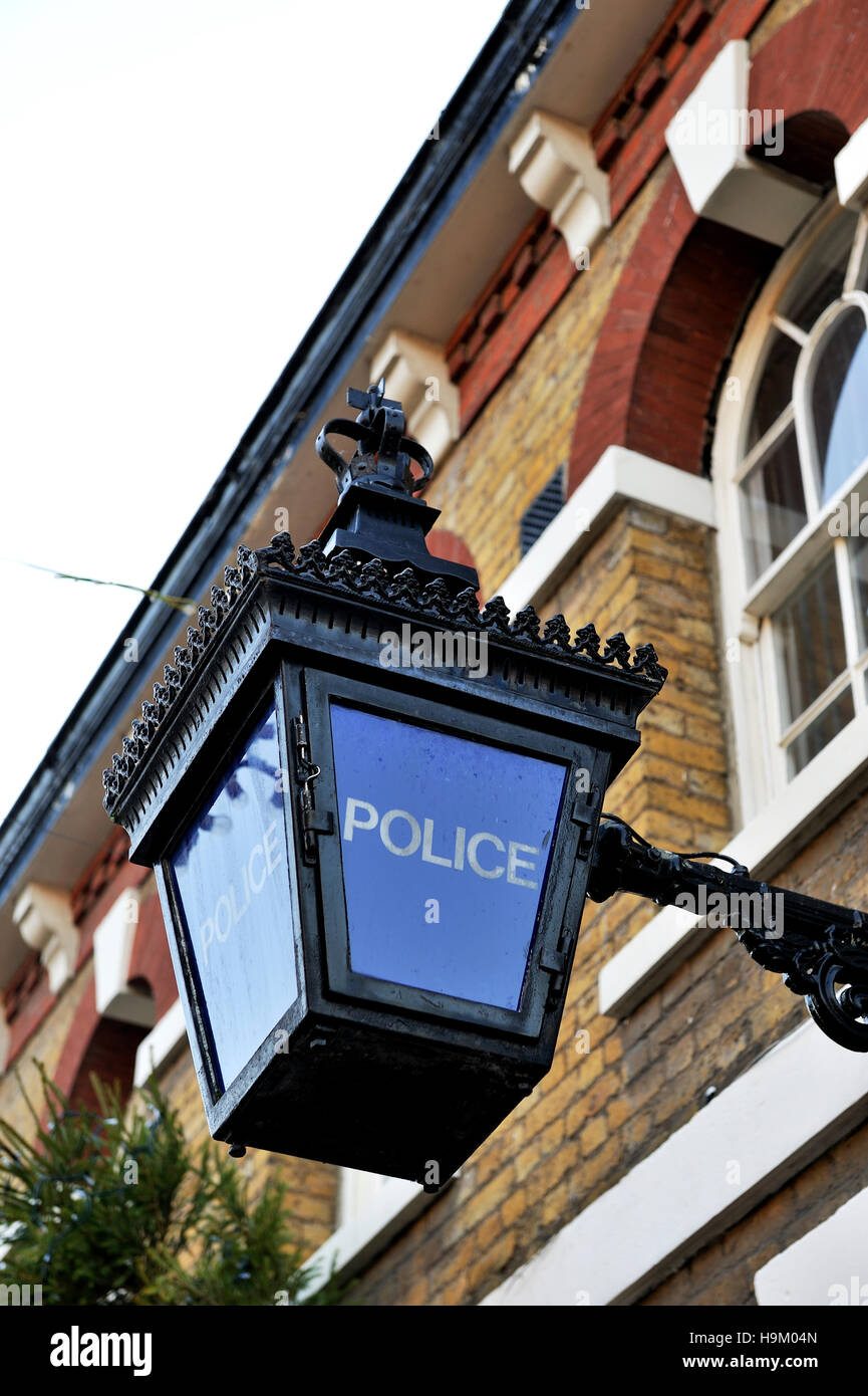 An old fashioned police lamp outside the police station at Waltham Abbey, Essex, England, United Kingdom, Europe - Stock Image
