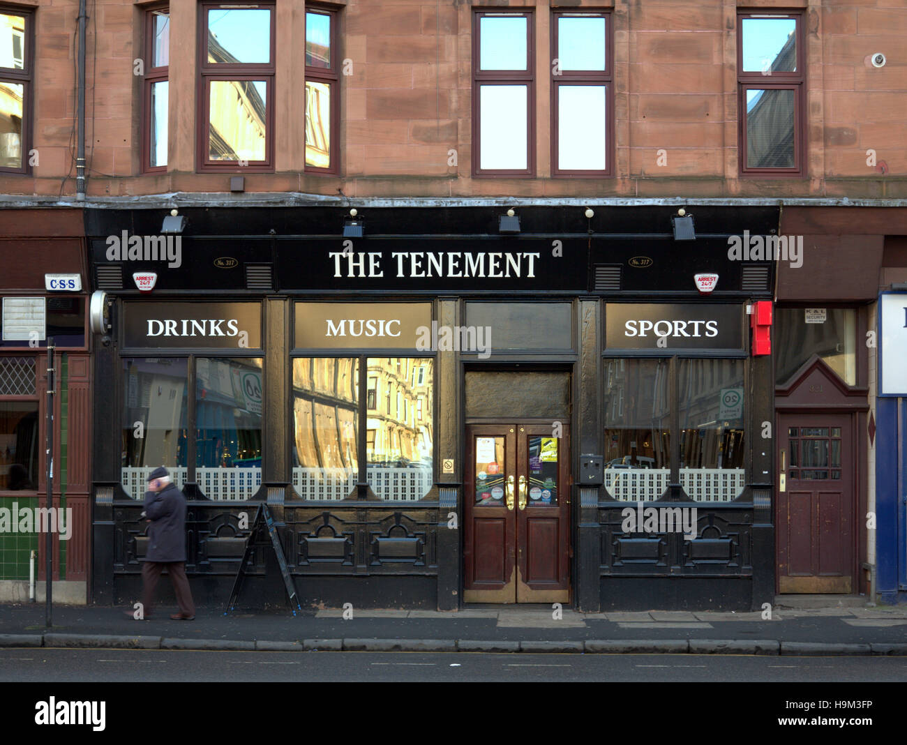 aptlly named tenement pub partick Glasgow - Stock Image