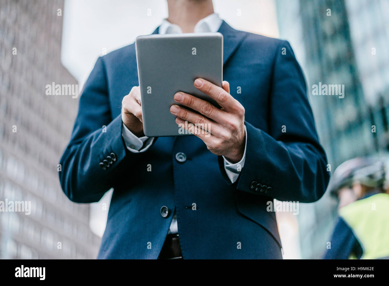 Businessman using talet, close-up - Stock Image