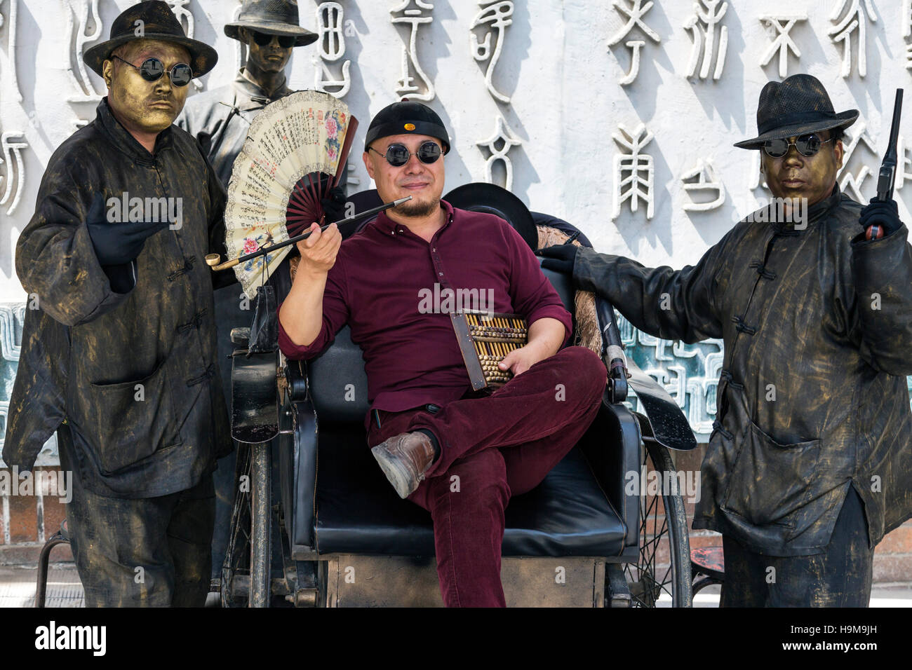 Chinese man posing for gangster portrait, Xian, China - Stock Image