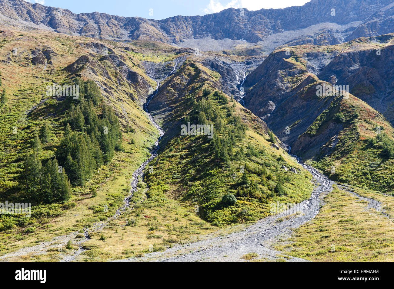 Val Veny Valle d'Aosta Italy rocks trees creeks green sky blue summer travel nature - Stock Image