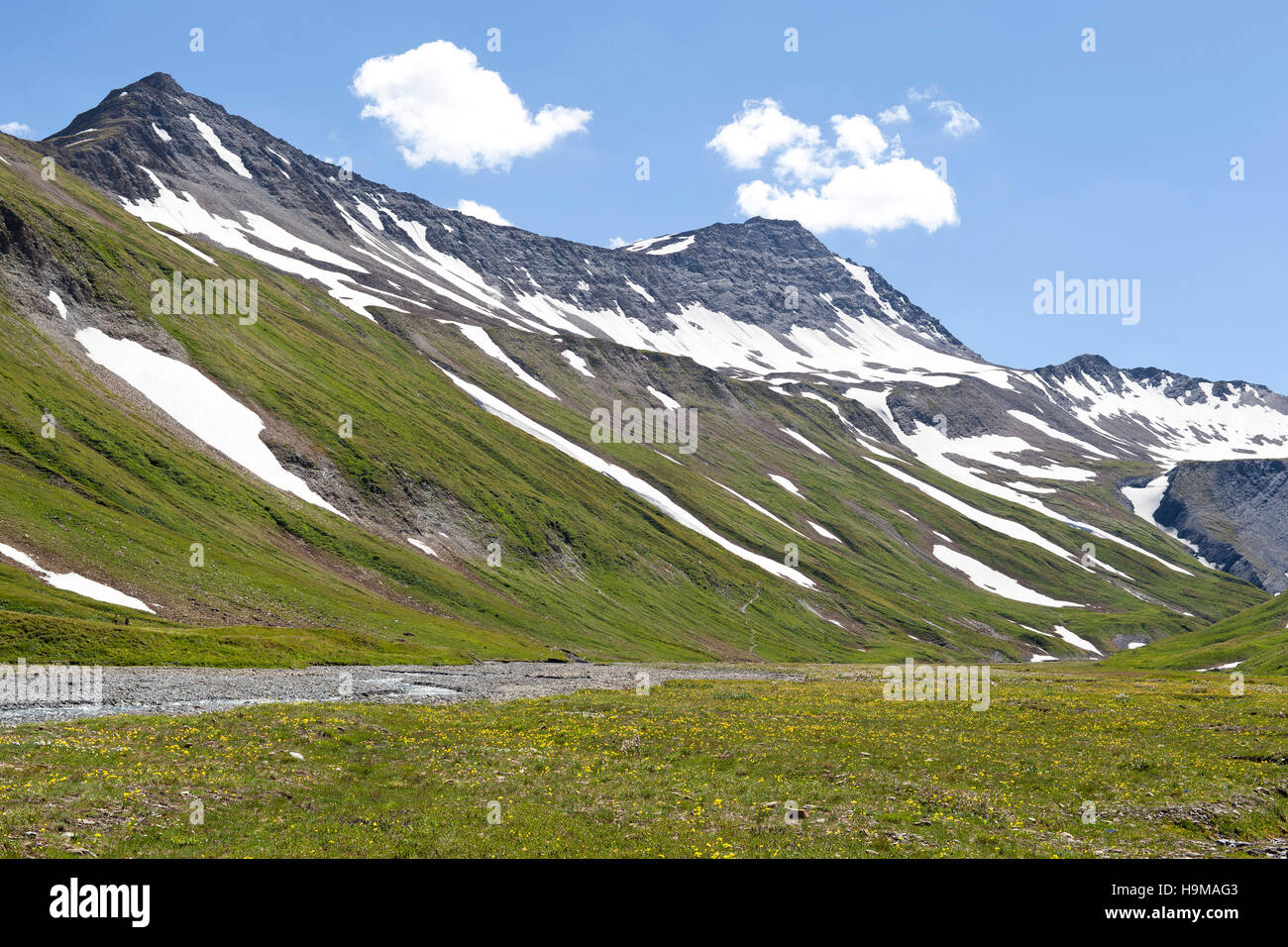 Val Veny Valle d'Aosta Italy rock snow mountains green river summer nature - Stock Image
