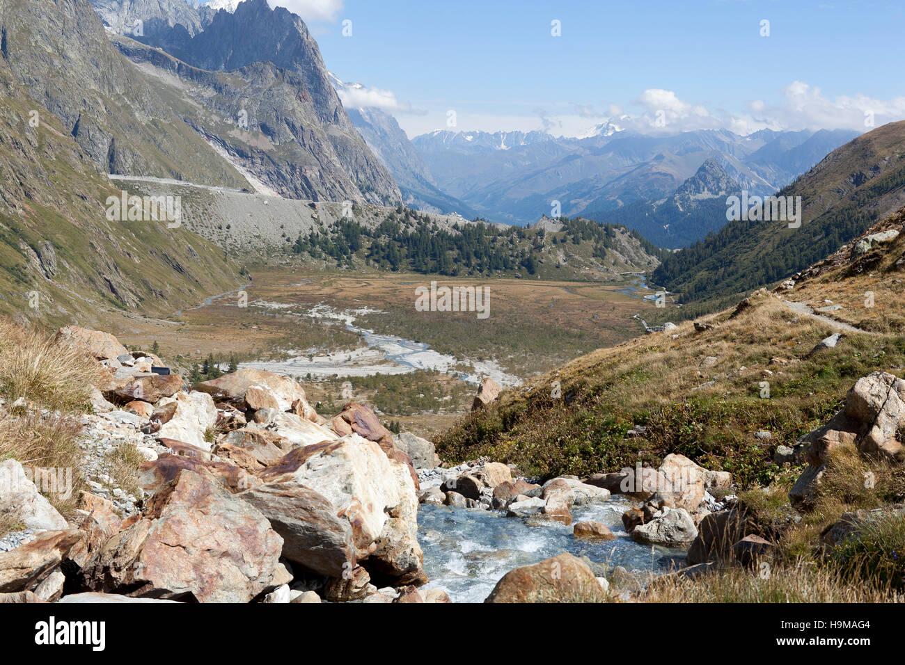 Val Veny Valle d'Aosta Italy river green mountains glacier rocks summer - Stock Image