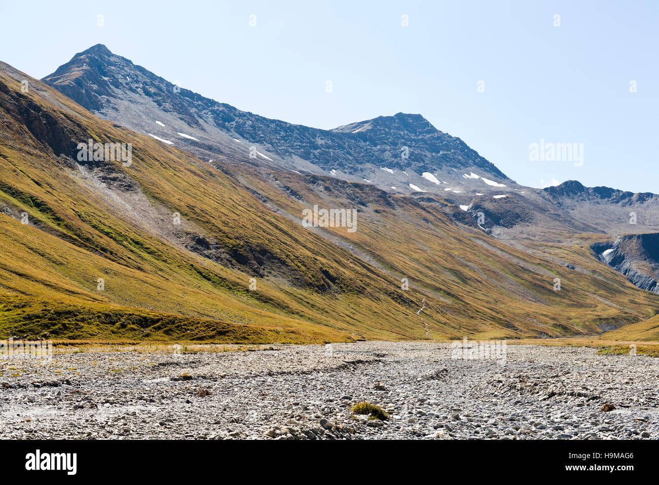 Val Veny Valle d'Aosta Italy rocks river green sky blue summer travel - Stock Image