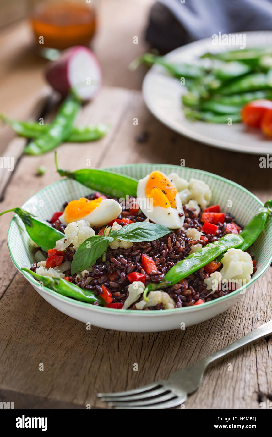 Thai Rice berry with Boiled egg  and Snow pea salad - Stock Image