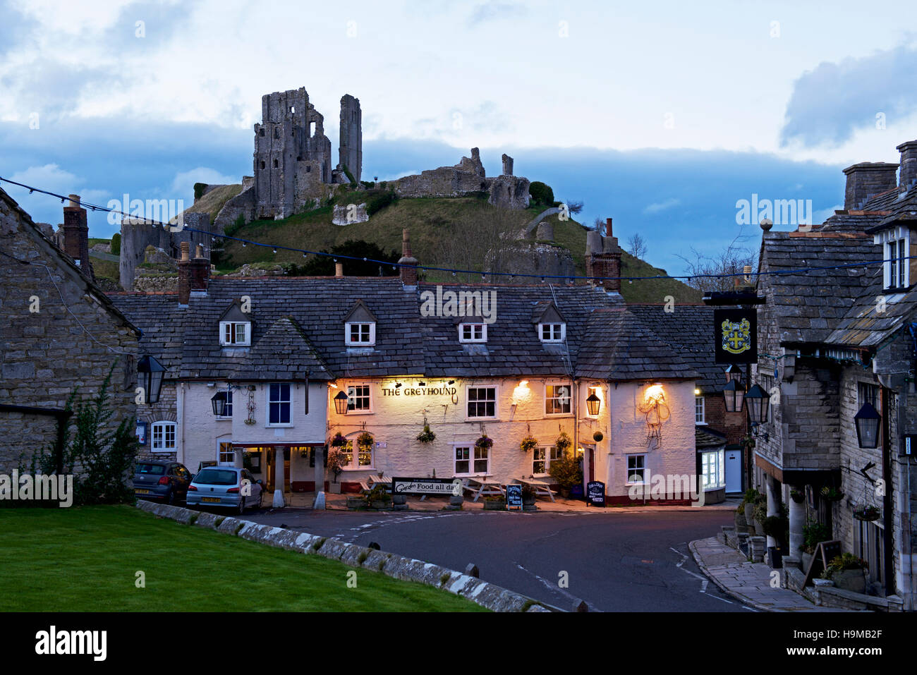 Corfe Castle and the Greyhound Inn, Isle of Purbeck, Dorset, England UK - Stock Image