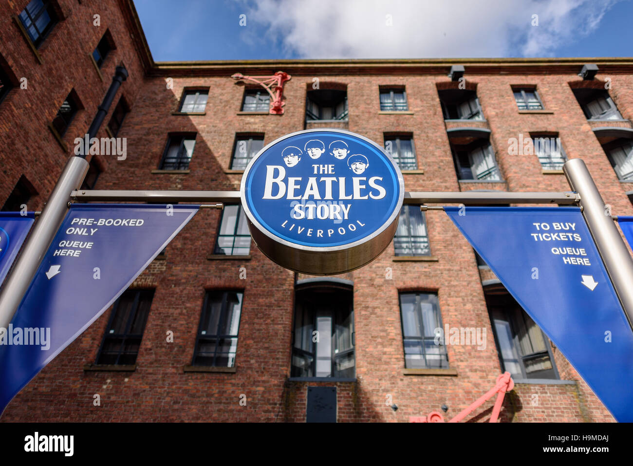 The sign for 'The Beatles Story' Exhibition at the Albert Dock in Liverpool. *EDITORIAL* - Stock Image