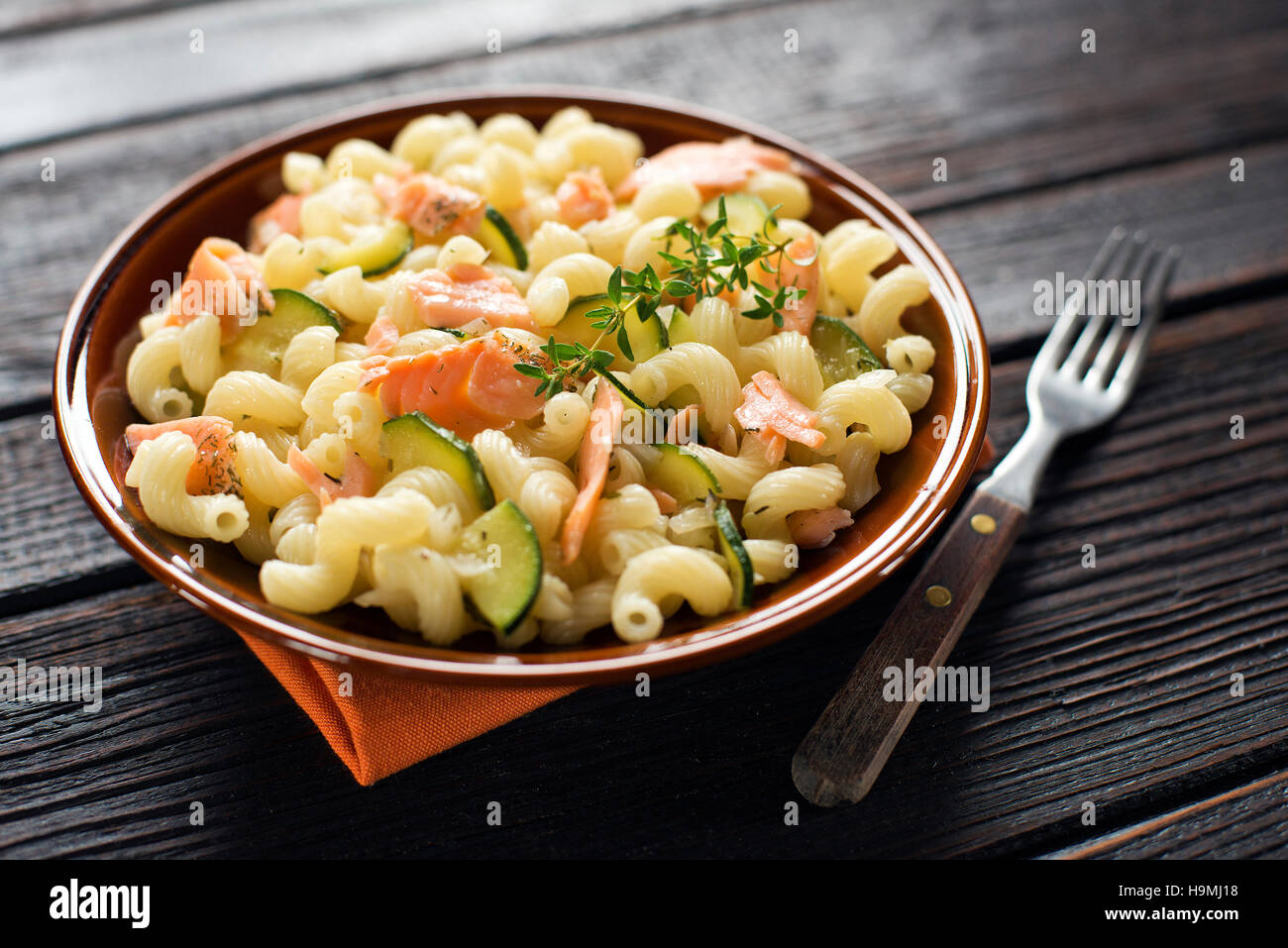 Fresh pasta with smoked salmon and vegetable - Stock Image