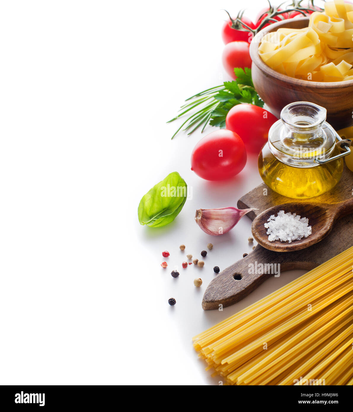 Raw Pasta with ingredients on white background Stock Photo