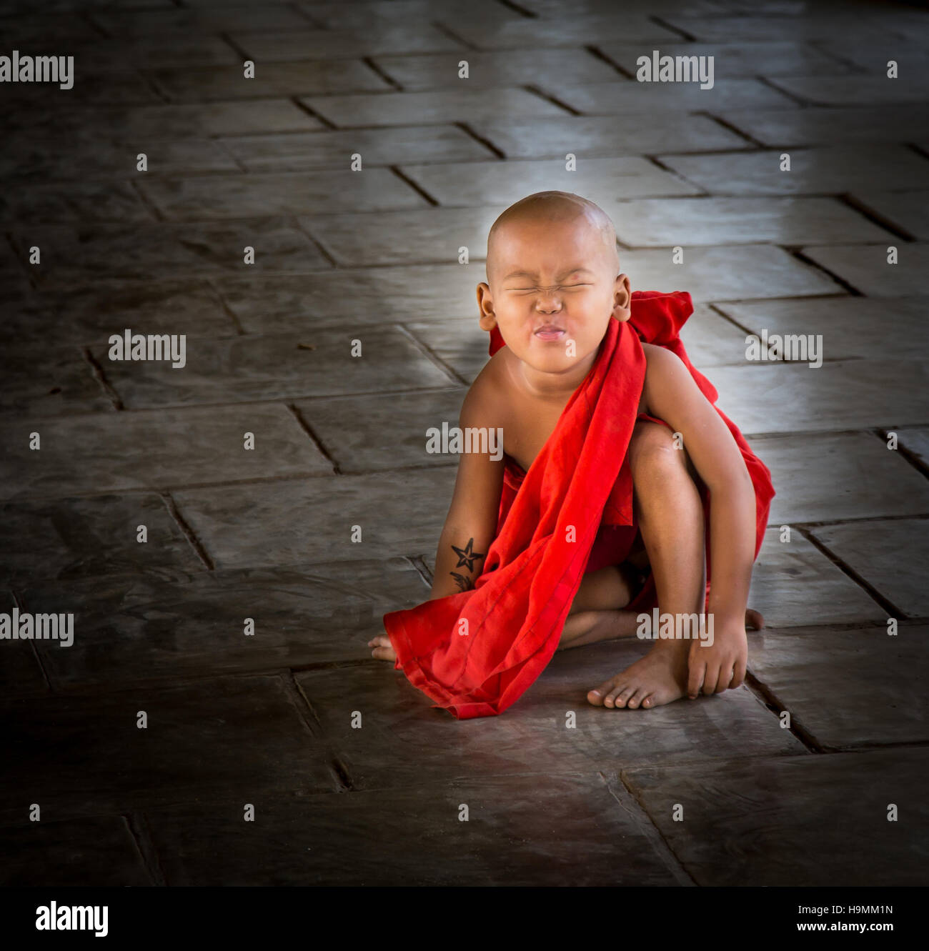 Young Monk scowling at  the Camera - Stock Image