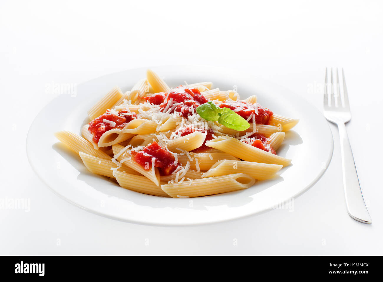 Plate of penne pasta with tomato sauce and parmesan cheese - Stock Image