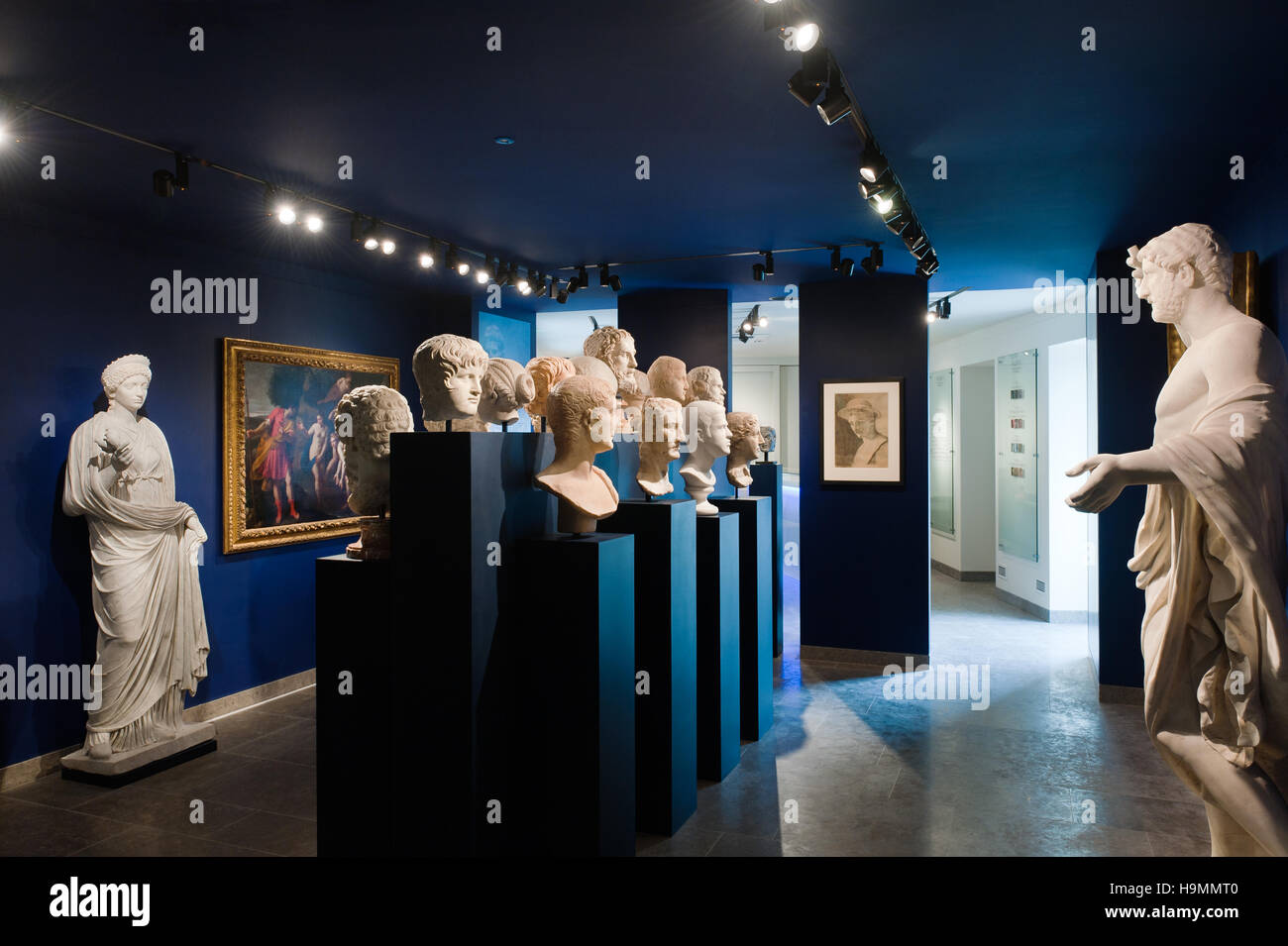 Collections of staues and bust on blue plinths in Mougins Museum of Classical Art, France - Stock Image