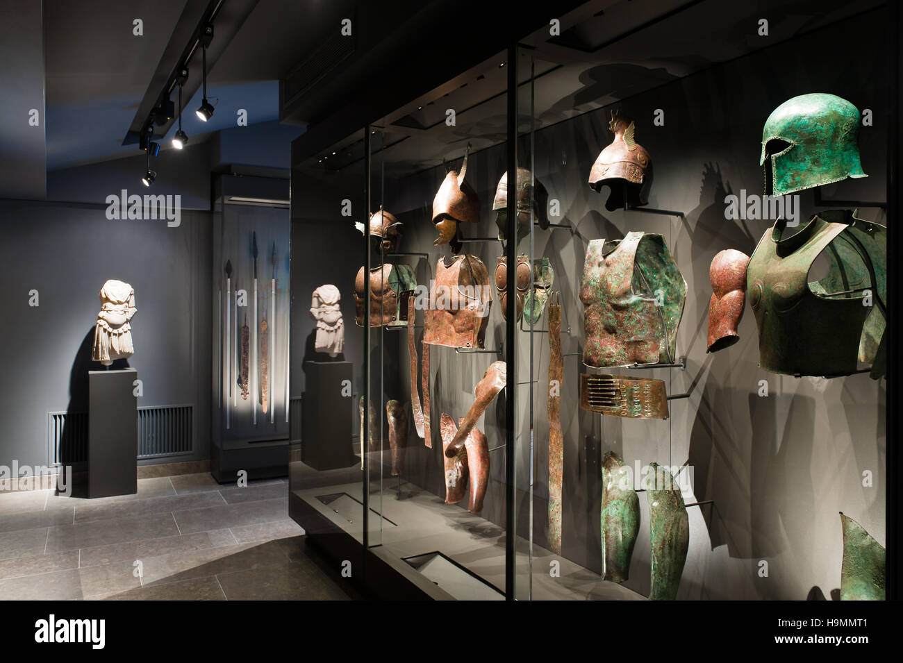 Chestplates and helmets in a lit display case,  Museum of Antiquities, Mougins, France - Stock Image