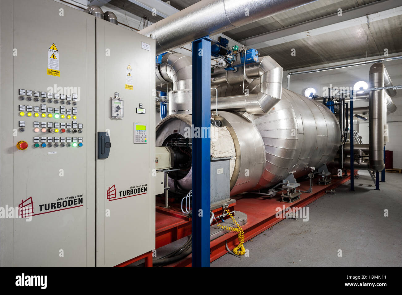 Compression machinery in timber processing plant, Templin, Uckermark district of Brandenurg, Germany. - Stock Image