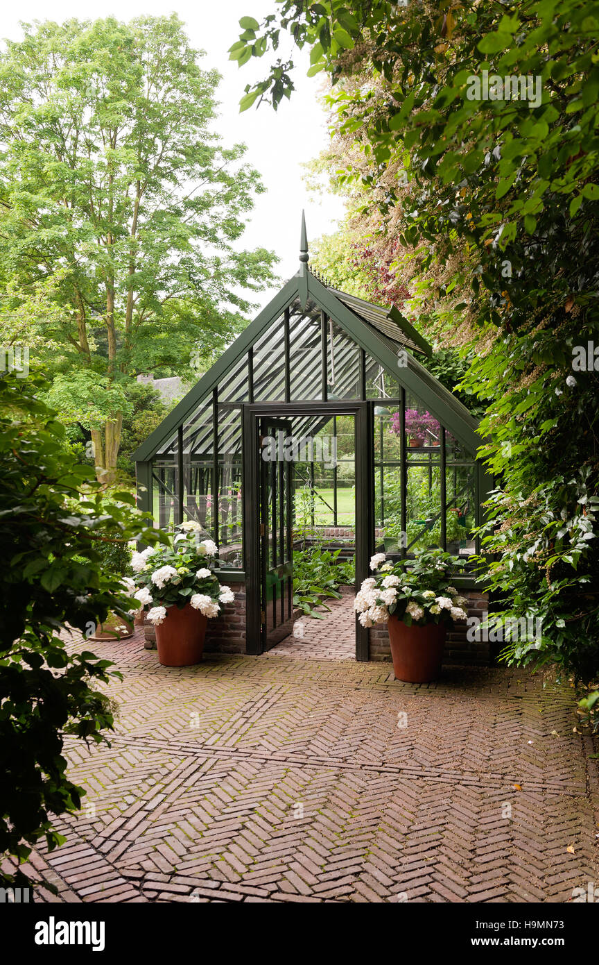 Greenhouse in grounds of German home - Stock Image