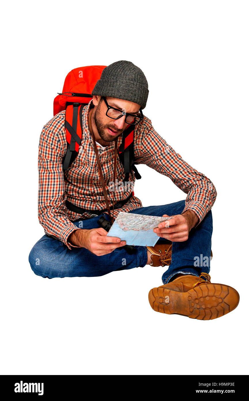 Explorer man browsing map over white background. - Stock Image