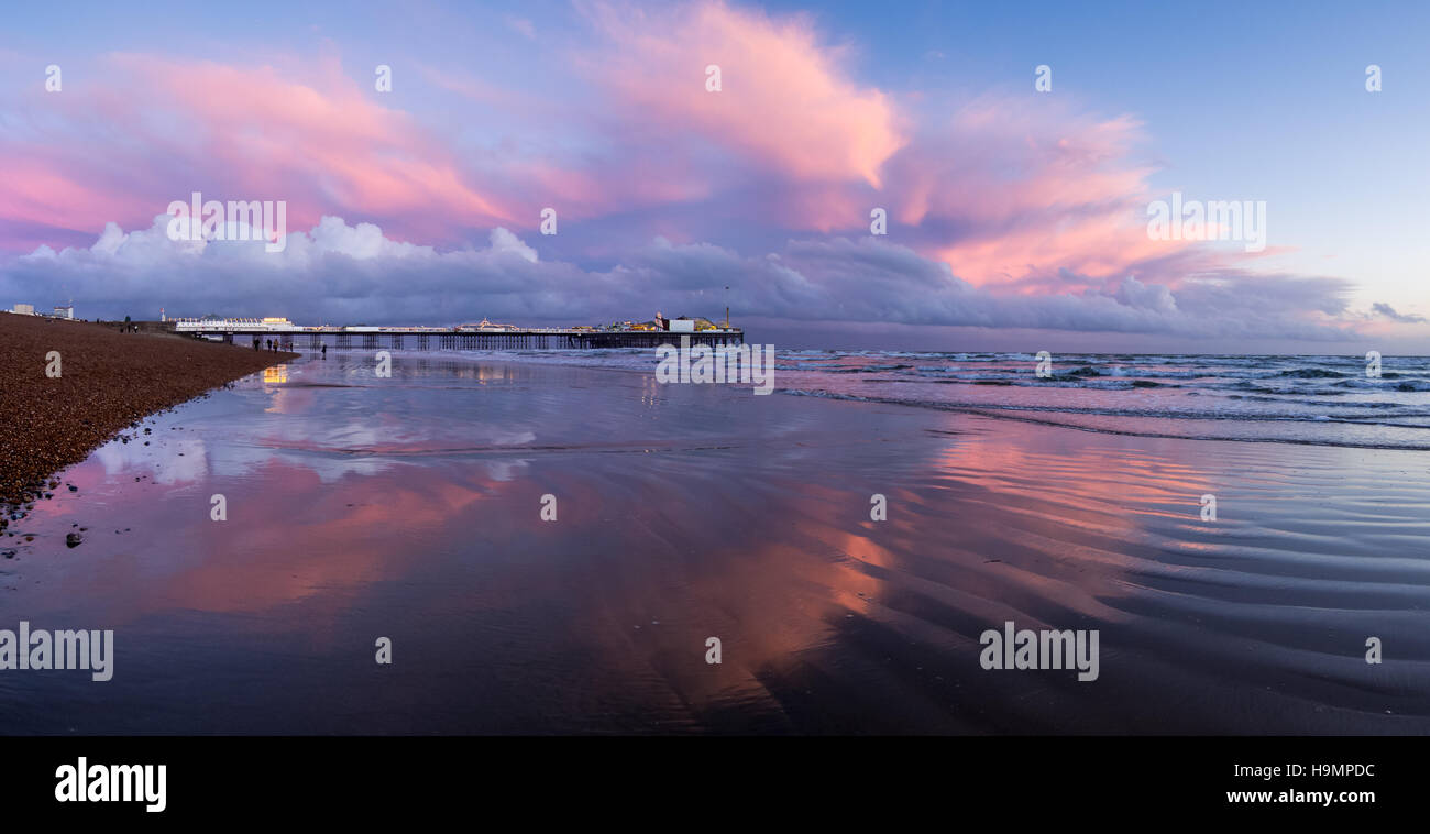 Panorama of Pink clouds around Brighton Palace Pier - Stock Image