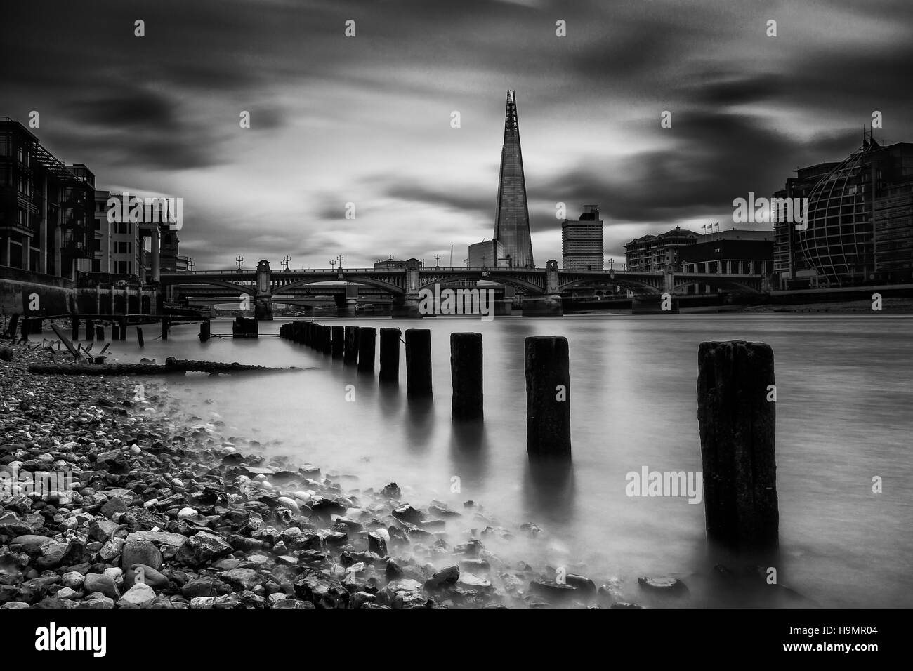 Low tide near Blackfriars in London - Stock Image