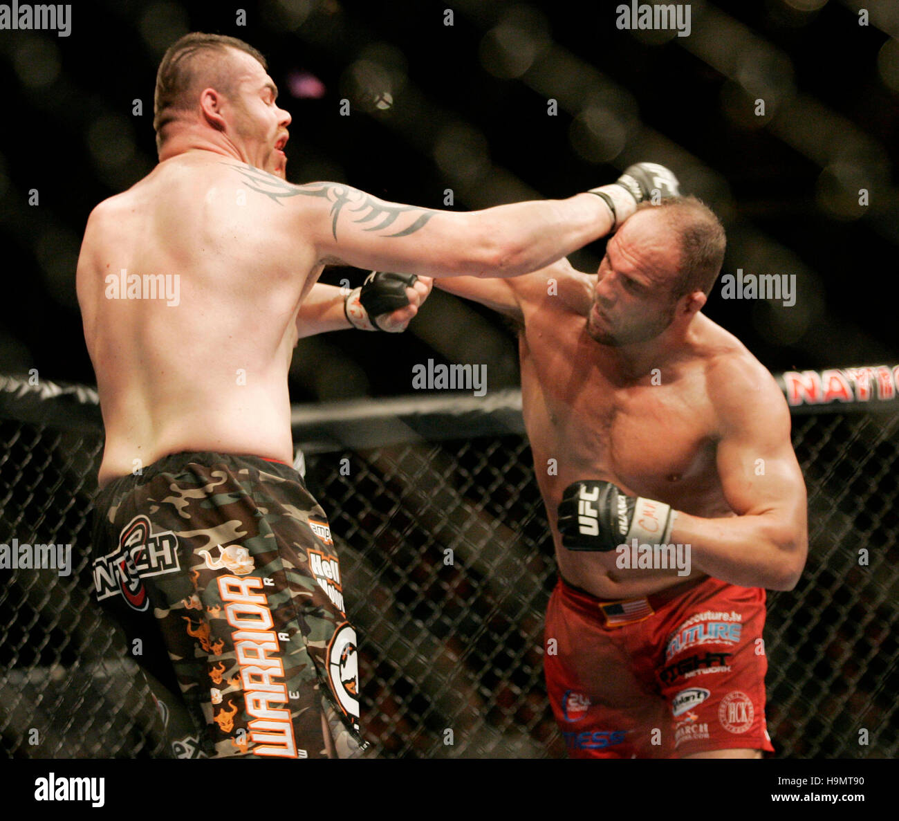 Randy Couture, right, fights Tim Sylvia during Ultimate Fighting Championship UFC 68 at the Nationwide Arena in Stock Photo