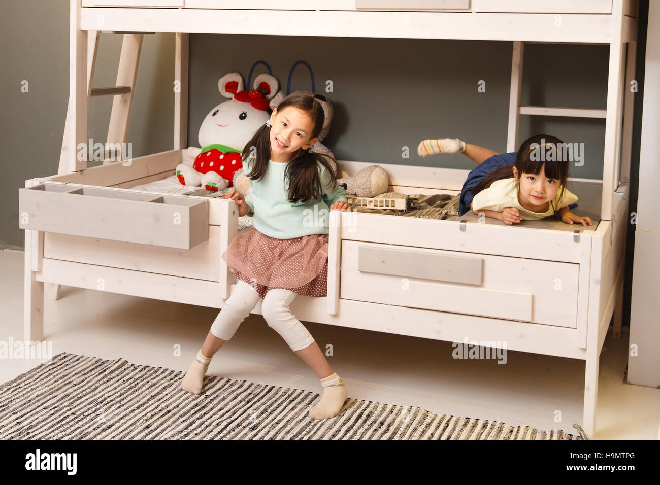 Cute little girl playing in the bedroom - Stock Image
