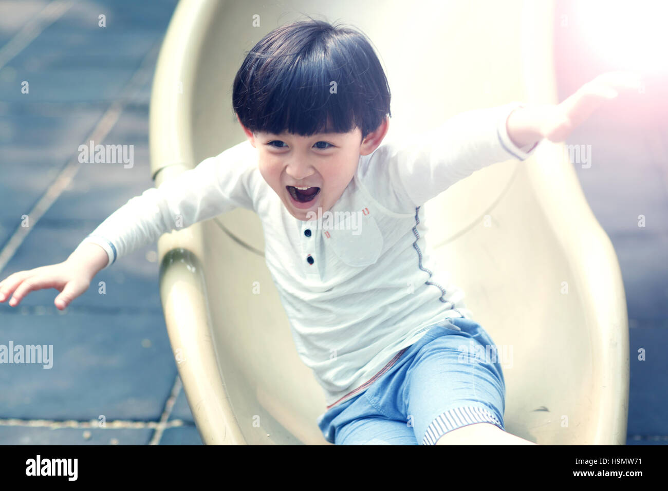 The little boy slides - Stock Image