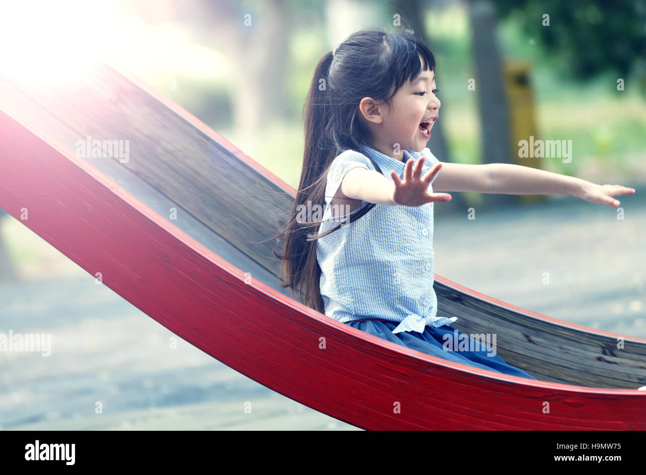 The little girl slide - Stock Image