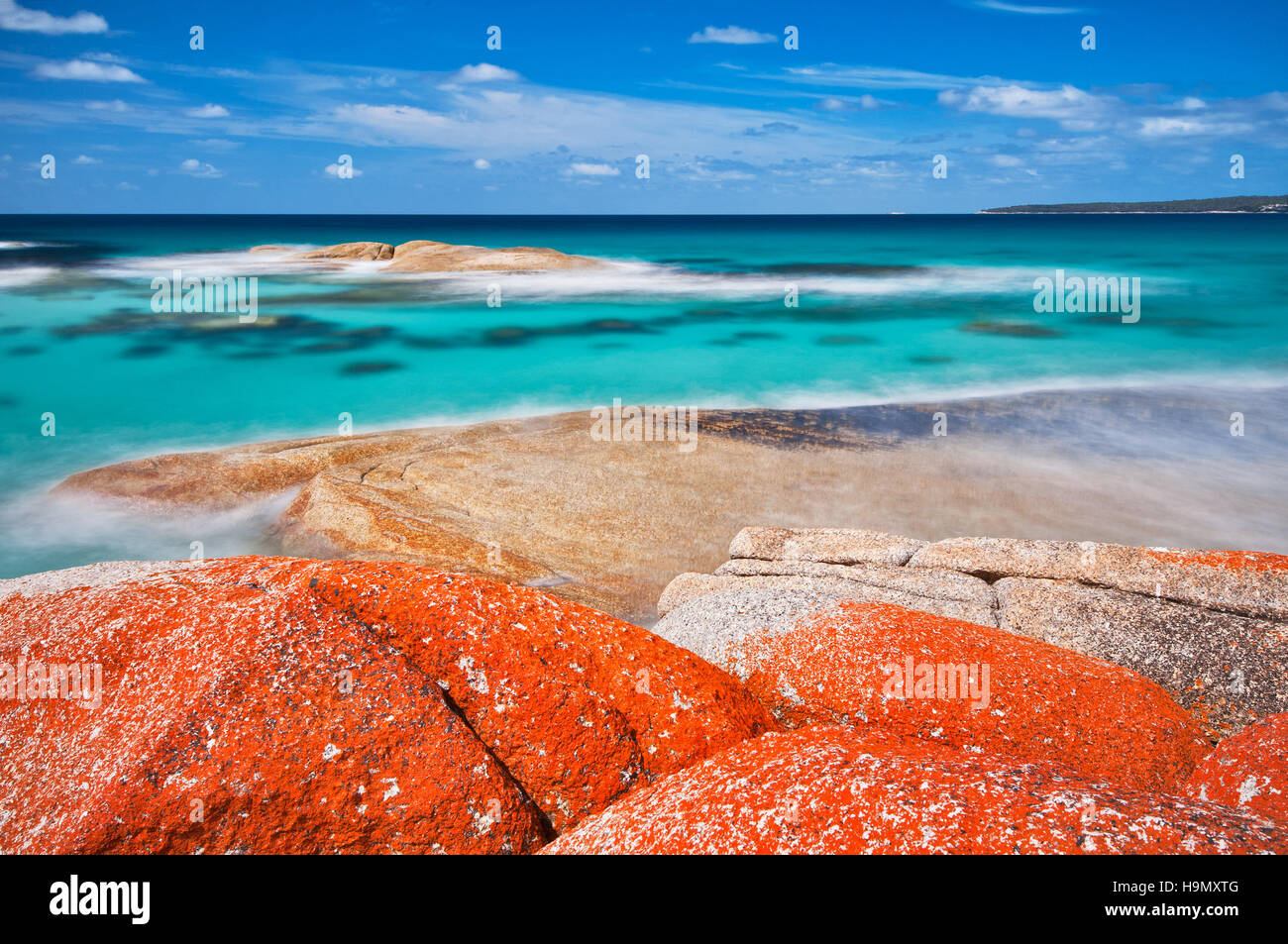 That is the coloured lichen where the Bay of Fires got its name from. - Stock Image
