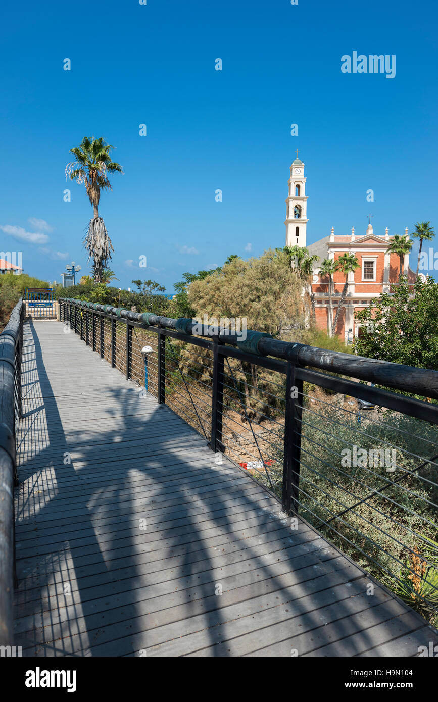 The famous wishing bridge in Jaffa (old Yafo) with St. Peter's Church seen in the background. - Stock Image