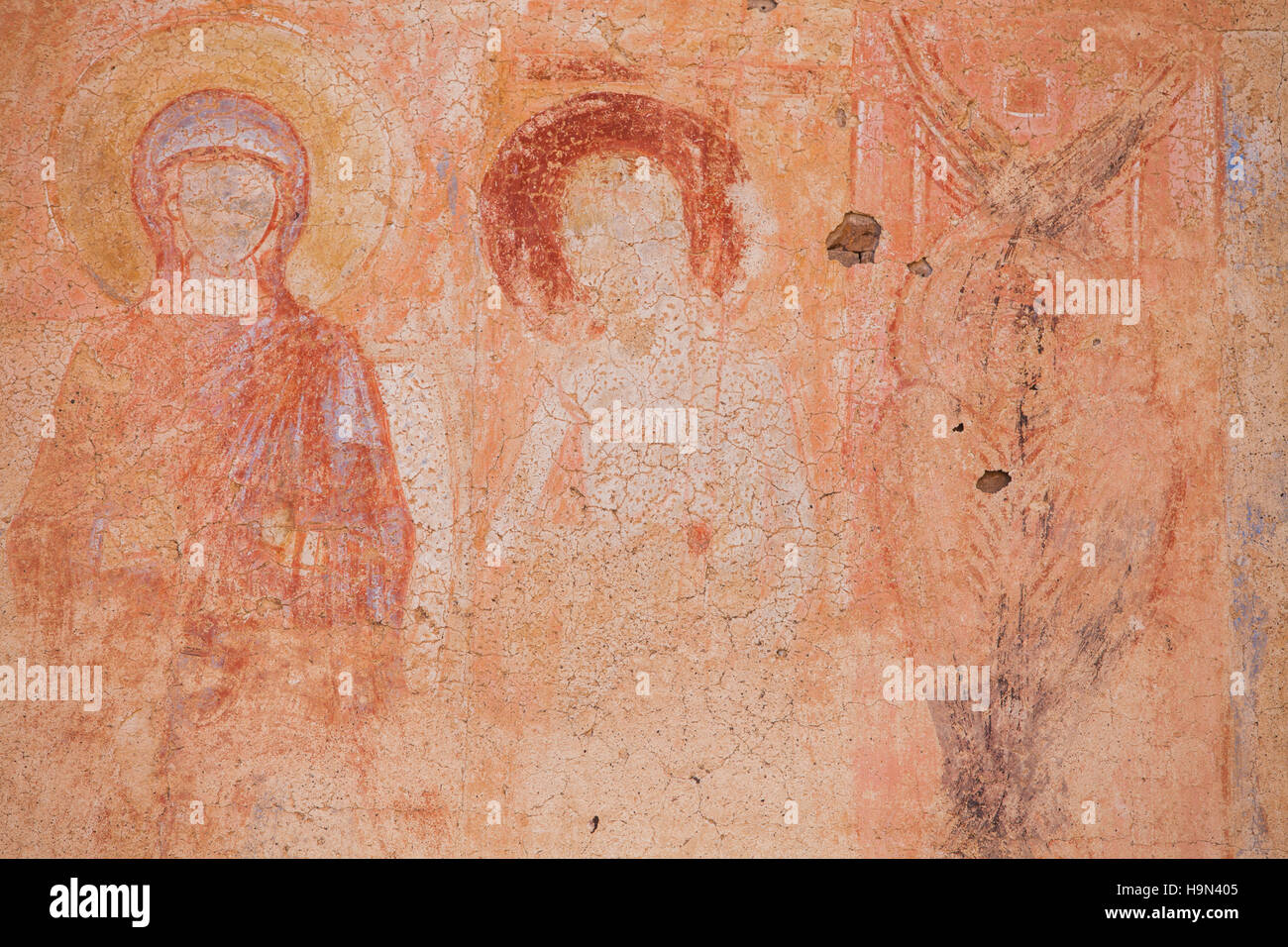Color detail of some paintings of saints in an abandoned church. Stock Photo