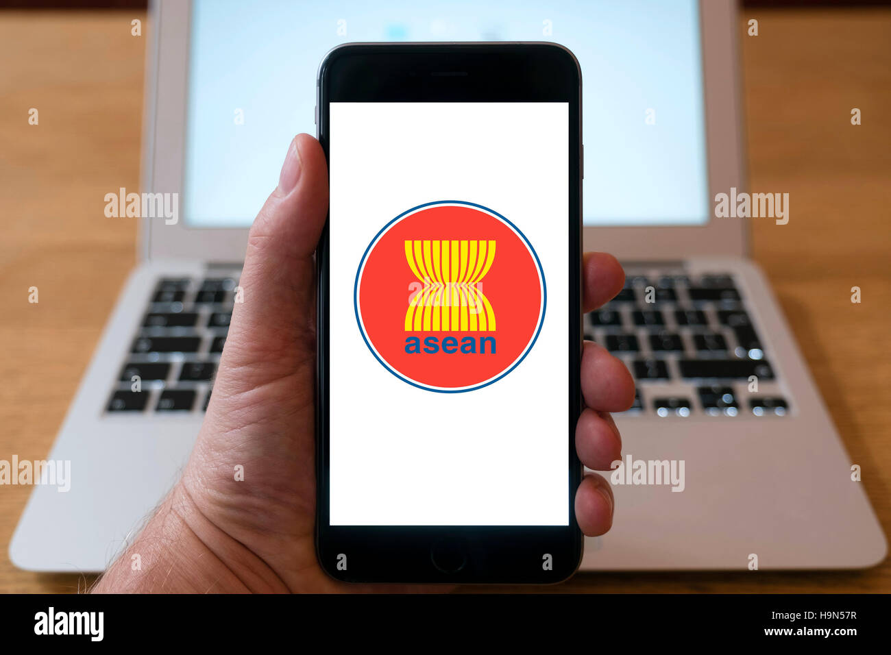 ASEAN financial organisation homepage on iPhone smart phone mobile phone - Stock Image