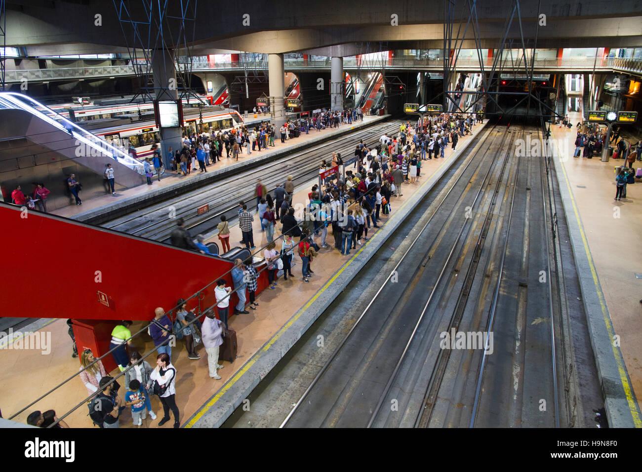 Madrid Spain Atocha railway station interior people waiting - Stock Image