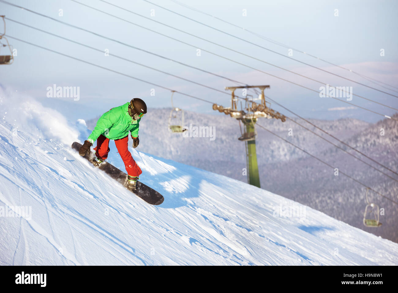 Snowboarder snowboarding riding downhill sheregesh - Stock Image