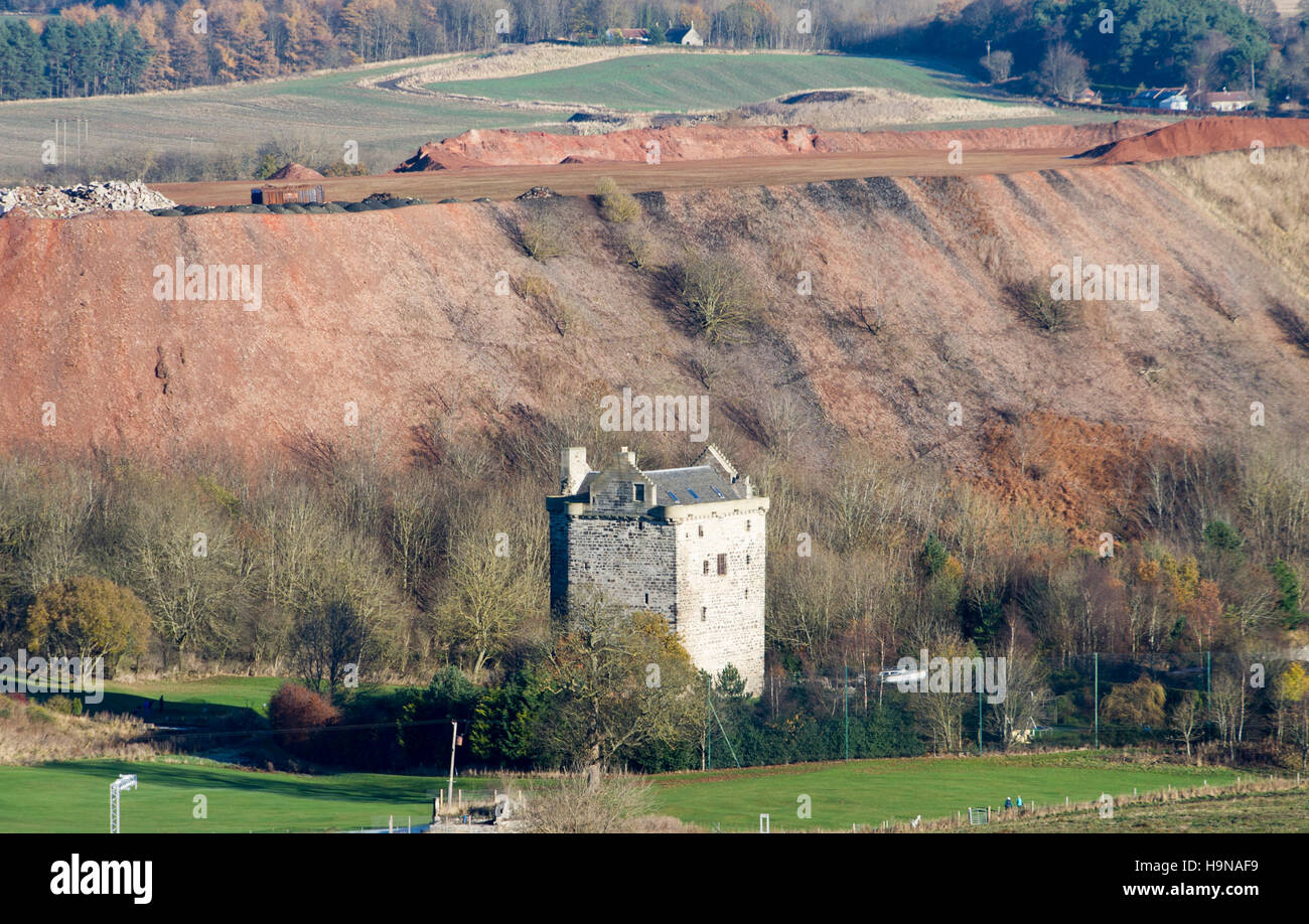 Niddry Castle and shale bing near Winchburgh West Lothian. - Stock Image
