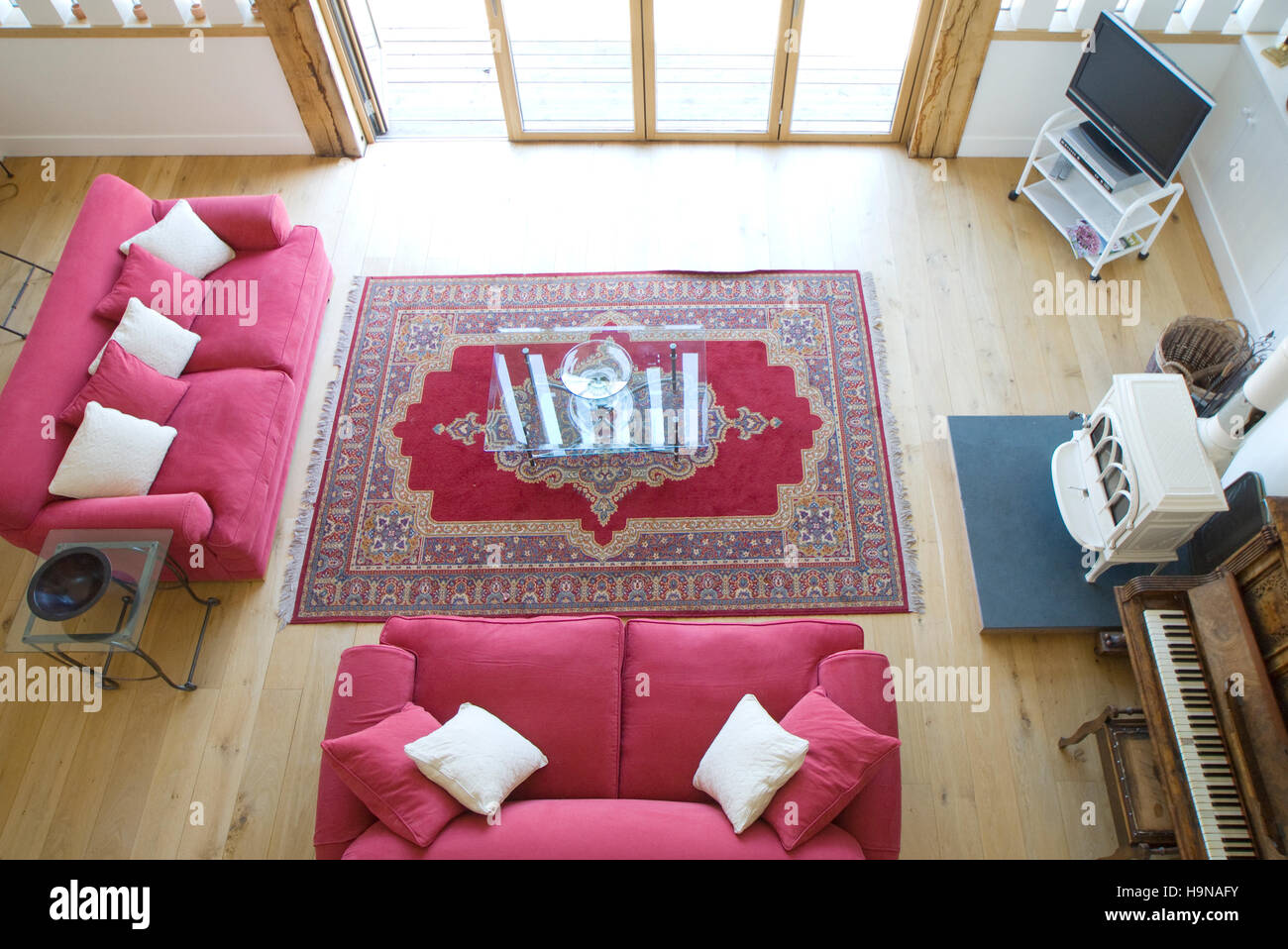 Living room with sofas, from above, with glazed doors. - Stock Image